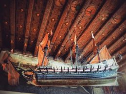 Where ships hang from ceilings as a symbol of the town's maritime past. Town Hall.