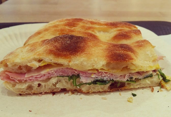 Toasted foccaccia with ham, emmenthal cheese and arugula.jpg